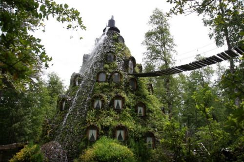 The Magic Mountain Hotel, located in the heart of Hulio Hulio natural reserve ,Chile. The hotel was built in the shape of a volcano, the fountain simulates a waterfall that runs through the hotel windows.