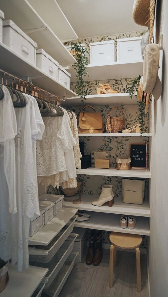 walk in closet with floral wallpaper