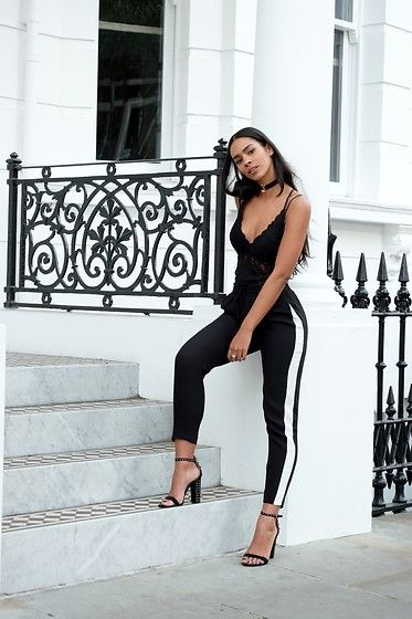 Get this look: http://lb.nu/look/8437925  More looks by Elvira Vedelago: http://lb.nu/carellestyle  Items in this look:  H&M Stripe Joggers, River Island Circle Velvet Choker, Zara Studded Barely There Heels   #casual #chic #effortless #monochrome #lingerie