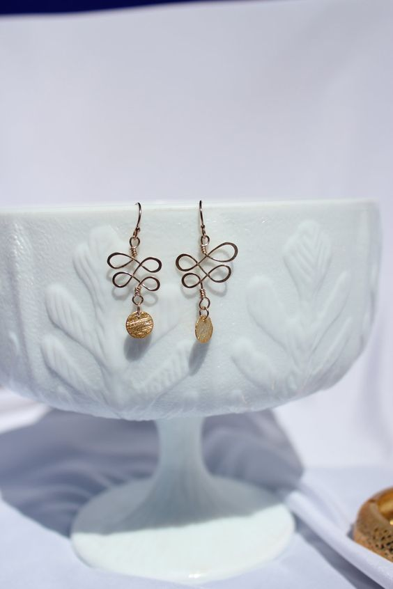 Simple 14k Gold Filled Hammered Wire Earrings With Gold Disk. $36.50, via Etsy.