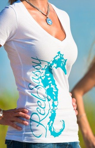 REEL SASSY DEEP V-NECK SEAHORSE T-SHIRT     Product Description:         A deep v-neck and slim body in this baby rib style V-neck shirt creates a sexy silhouette. Reel Sassy Seahorse climbs up the side for a simple and stunning effect.     100% combed cotton jersey, pre-shrunk.    $24.95    www.reelsassy.com