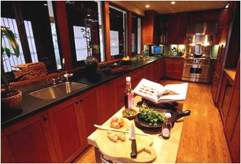 Cherry Wood Cabinets, Black Granite Countertops, Stainless Steel Appliances: