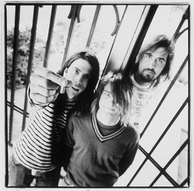 Had this picture of Nirvana hanging on the outside front of my bedroom door as a teenager. #grunge