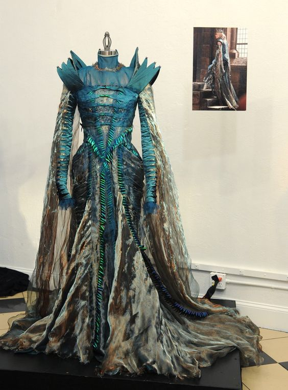 A beetle-wing dress made with silk taffeta and shreds of silk chiffon worn by Charlize Theron's Queen Ravenna.