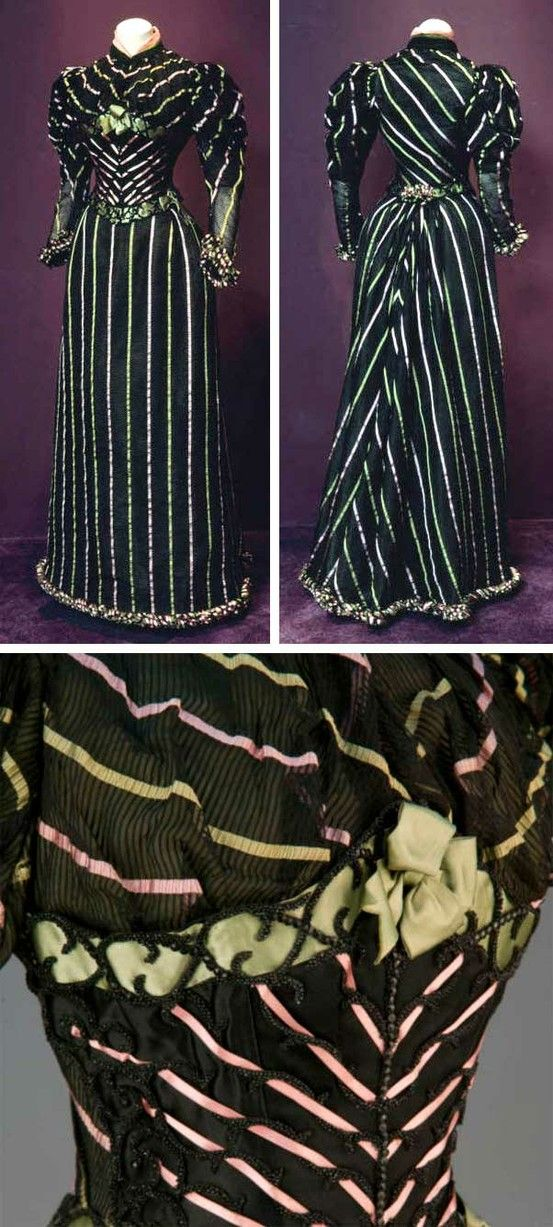 Dress, Robina, Paris, 1893. Black silk with pink and green accents. Fitted bodice with small standing collar; long leg-o-mutton sleeves. Black boned silk satin stomacher trimmed with green and pink ribbons and jet beading. Center front hook & eye closure; stomacher fastens at proper left side seam. Straight, floor-length skirt with hook & eye closures at center back. Chicago History Museum