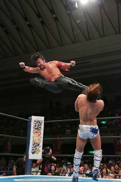 Shinsuke Nakamura with a vicious flying kick to the face of Kota Ibushi