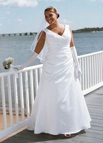 Side-draped bodice and off-the-shoulder neckline create a long, elegant look.   Designed in sumptuous satin, this lovely A-line silhouette also boasts a pretty lace-up back.  Chapel train.  Available inWhite or Ivory.  Also available in extended plus sizes 28W-30W, Style 9T9861WE, (special order only).  Missy: T9861. Sizes 0-16.  *Special Value: Was ; Now ! (final selling price; no additional discount may be applied).