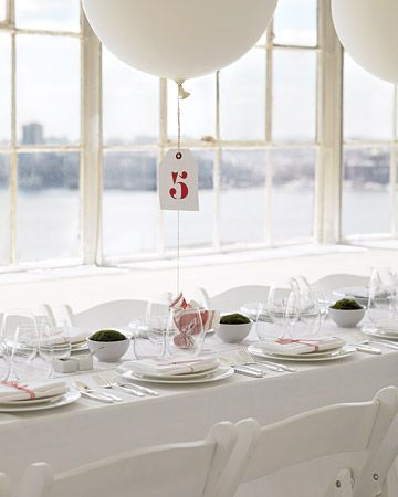 Oversized helium balloons tied with baker's twine to small rocks wrapped in red-and-white striped cotton shirting alternate with white bowls filled with cushion moss.    Read more at Marthastewartwedd...: Wedding Centerpiece Ideas by Color -- Martha Stewart Weddings