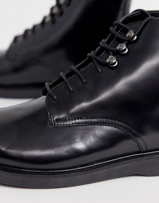 h by hudson battle lace up boots in black leather