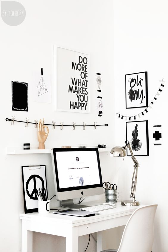 Simple office/workspace, love the black and white decor and the quote on the wall: