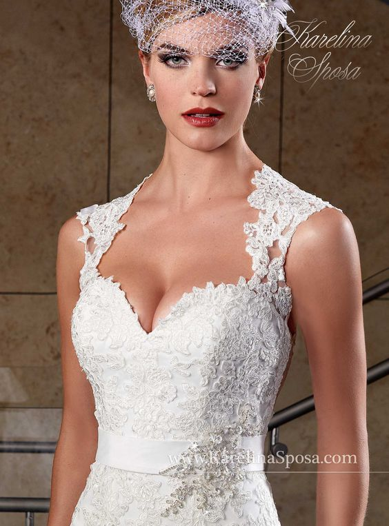 Style S15-C8002. Tulle, re- embroidered lace applique, Jewel beaded belt. Keyhole back. Suggested Retail price  $1527,00-$1654,00.