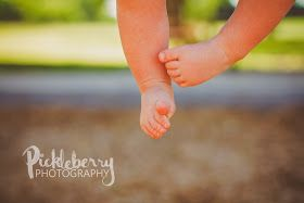1 year old photo pose idea. Close up on the toes while swinging. Park child family photography session