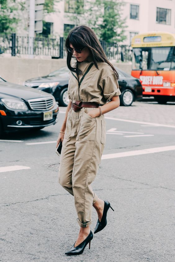 The jumpsuit is surely the epitome of easy dressing and the street style stars were working them every which way at the shows. Dressed up with heels or down with sneakers, belted, loose, denim or khaki, a fashion lesson in how to wear your simplest summer piece yet.
