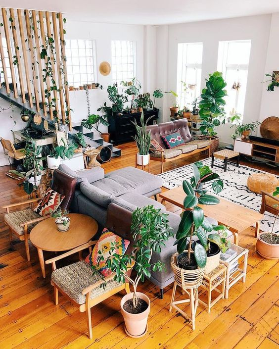 Jungle Loft â?¨Houseplants galore in this grey and wood color themed living room.
