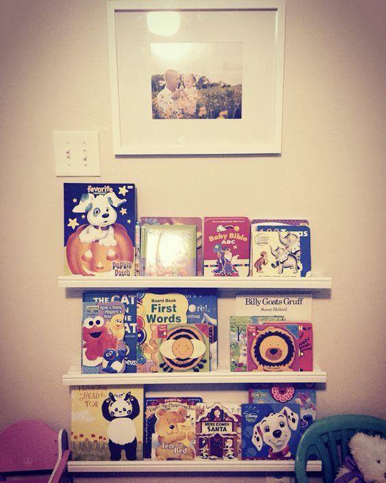 Faith 39 s new wall thanks to dada ikea picture ledges for Hobby lobby ikea blvd