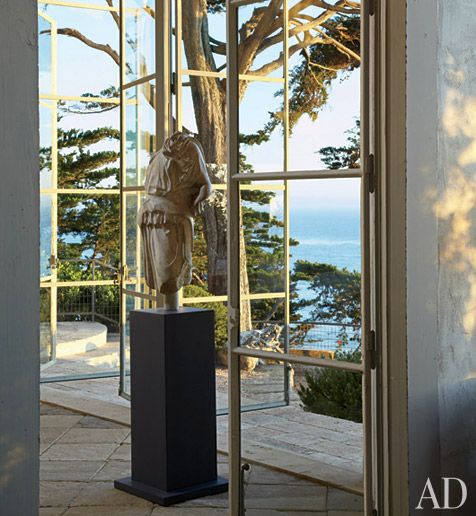Beuatiful. A painted steel pedestal displays a fourth-century Roman torso...overlooking Malibu of course :)