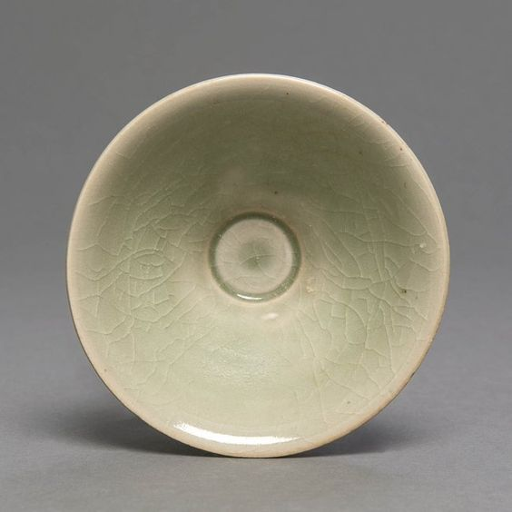 A small Yaozhou celadon bowl, northern Song, 11th/12th, covered in a bright transluscent pale green crackled glaze, 10.4cm diameter