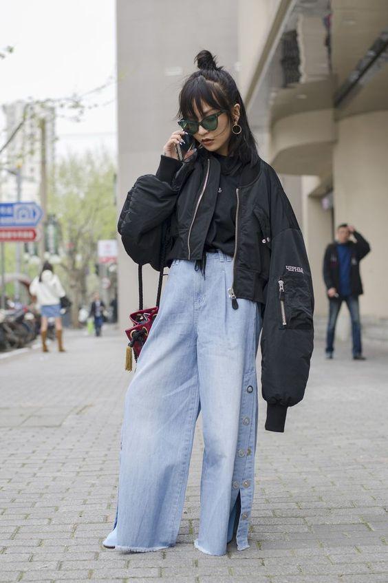 Top knot + black jacket + wide-legged denim pants | Shanghai Fashion Week street style [Photo: Dave Tacon]