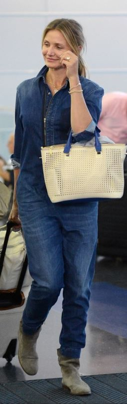 Who made Cameron Diaz's tan suede ankle boots, blue denim jumpsuit, and white handbag? Jumpsuit – Stella McCartney  Purse – Chloe  Shoes – Isabel Marant