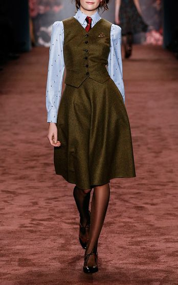 """Lena Hoschek With a collection appropriately named """"The Brits"""", the Austrian designer pays homage to national icons including the Queen and infamous literary characters, Miss Marple and Sherlock Holmes. But the collection is anything but cliché. A series of well-to-do tweeds and earthy florals create elegant looks perfect for channeling your inner English rose."""