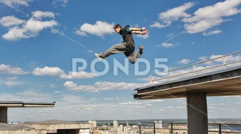 Man Jumps From Roof To Roof Parkour Stock Photos Ad Roof Jumps Man Photos Parkour Man Photo Roof