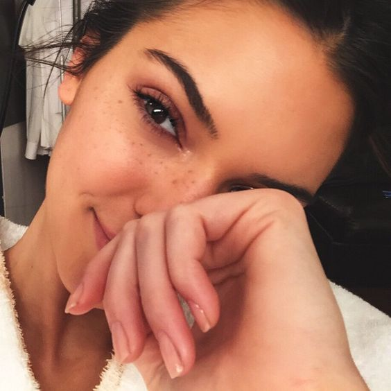 Kendall Jenner flaunted her freckles in an Instagram selfie earlier this year with barely there makeup.: