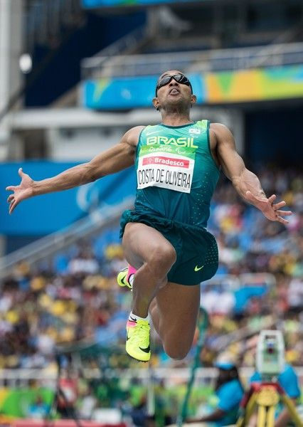 Handout image supplied by OIS/IOC showing Brazilian Ricardo Costa de Oliveira competing during the Men's Long Jump T11 Final during the Rio 2016 Paralympic Games at the Olympic Stadium in Rio de Janeiro, Brazil, on September 8, 2016...Costa de Oliveira won the gold ahead of USA's Lex Gillette and Ukraine's Ruslan Katyshev. Photo by Simon Bruty for OIS/IOC via AFP.  RESTRICTED TO EDITORIAL USE. / AFP / OIS/IOC / Simon Bruty for OIS