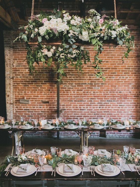 Romantic tablescape with hanging florals at Marvimon. Dinnerware by Casa de Perrin