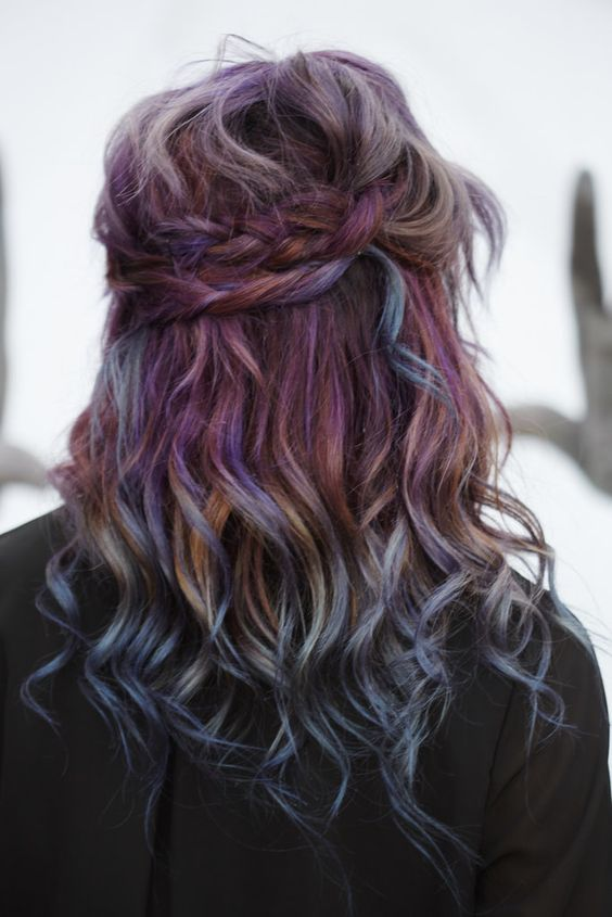 Take your rainbow strands into fall with deep purple hues and subtle orange accents.