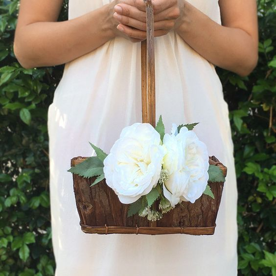 This handmade basket decked with white and cream flowers is the perfect accessory for your flower girl walking down the aisle. Delivery across Australia.