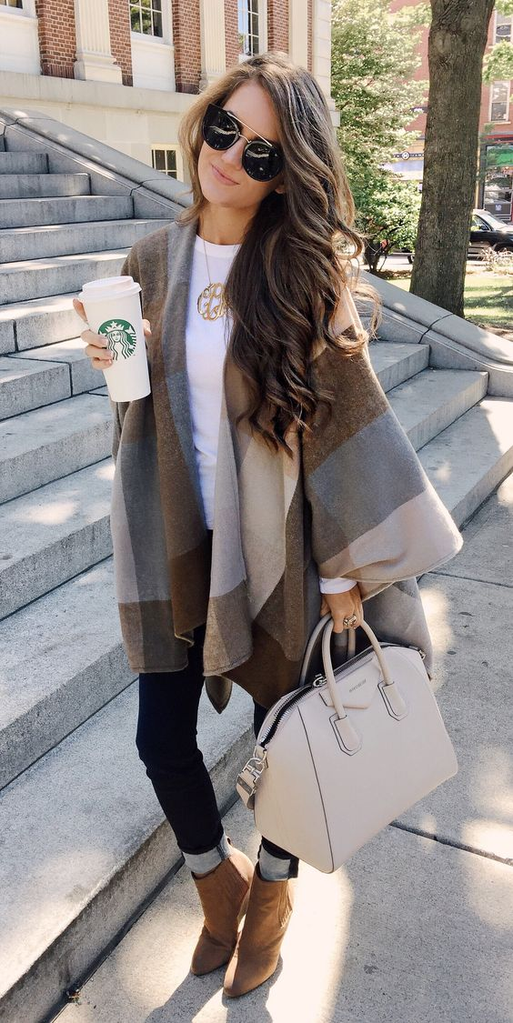 Poncho + jeans + booties + Givenchy bag. Fall outfit inspo: