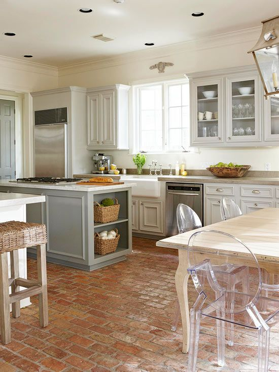 Pale gray cabinets are a pretty contrast to this kitchens rustic brick floor. Tour the rest of this madeover home: http://www.bhg.com/decorating/makeovers/before-and-after/a-neutral-decorating-makeover/?socsrc=bhgpin071912brickfloorkitchen#page=2 LOVE the brick floor for a cottage! Reminds me of France :)