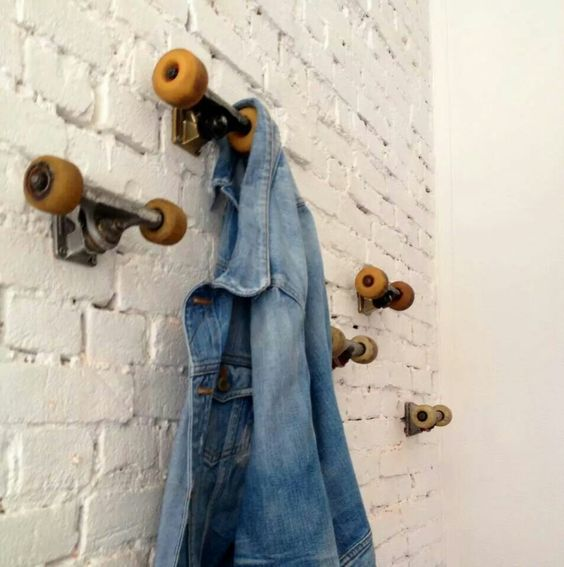 skate board wheels for hooks. Teen bedroom idea.: