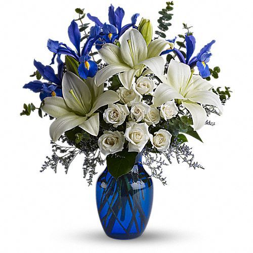Blue Horizons  As open and bright as a winter's sky, this exquisite mix of white and blue blossoms would make a stunning birthday gift, or a superb Hanukah present for a favorite friend or family member. An eye-catching selection.: