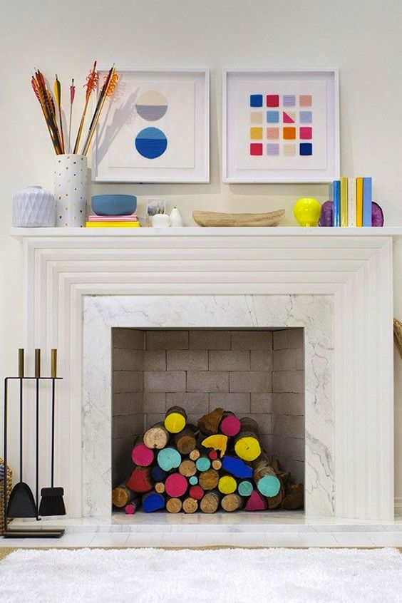 Decorate an unused fireplace with painted logs.