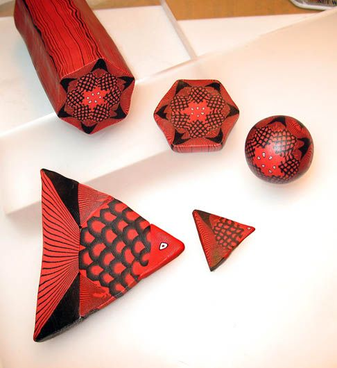 """Pure line and simple shapes, no skinner blends. Just intense red and black...with the smallest pinch of white for the eye. From """"How To Make a Geometric Fish Cane"""""""