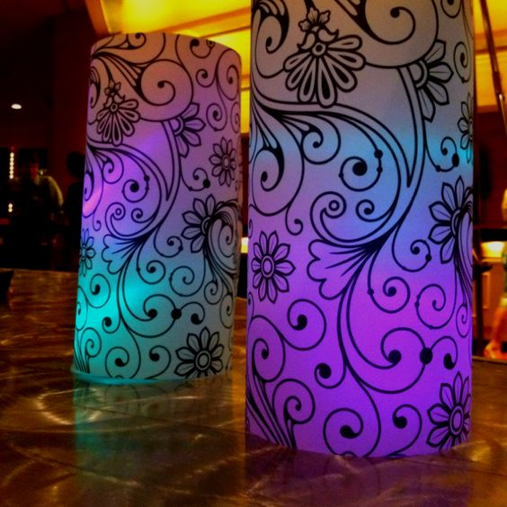 Simple wedding decor: heavy vellum 11 x 17 printed with scrolls. Inside are simple LED lights. One color place on ground then clear solo cup a second put on top for dual color. Cost: $1.12 each.: