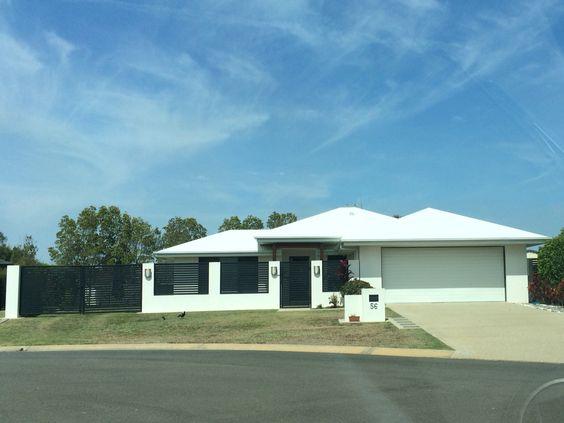 White On White Render Garage Door Roof Garage Doors New Homes Outdoor Decor
