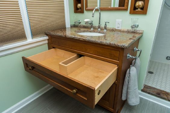 under sink drawer with cutout to fit around pipes for