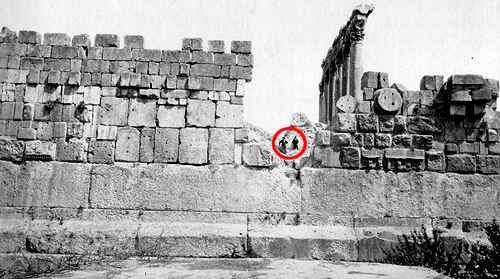 """The foundation of this terrace at Baalbek (Lebanon) is approximately 5 million square feet in size. Three colossal stones, known as """"the Trilithon"""", are the larger of the many visible megaliths in the terrace walls. They measure over 60 feet long, with widths of 12 and 14 feet (notice the two men in the center). Many Roman Ruins still stand on the platform, but the site is far older than the Roman Empire. Even the Sumerians referred to Baalbek as ancient."""