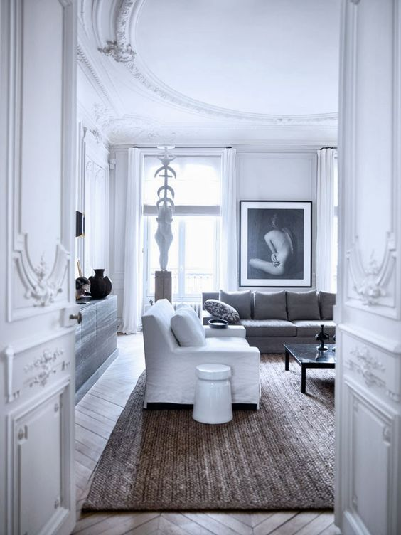 <p>Ornate and minimal are essentially opposites, but design duo Gilles et Boissier somehow embody both in their vision for this dreamy Paris apartment. The color palette of primarily white, black, and