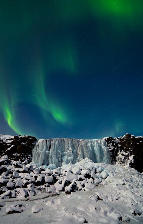 Aurora Borealis over Icefall, Öxarárfoss, Iceland