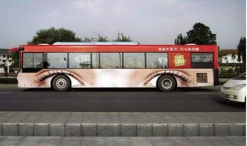 Don't look directly into the eyes!!! This bus wrap is the epitome of eye catching!