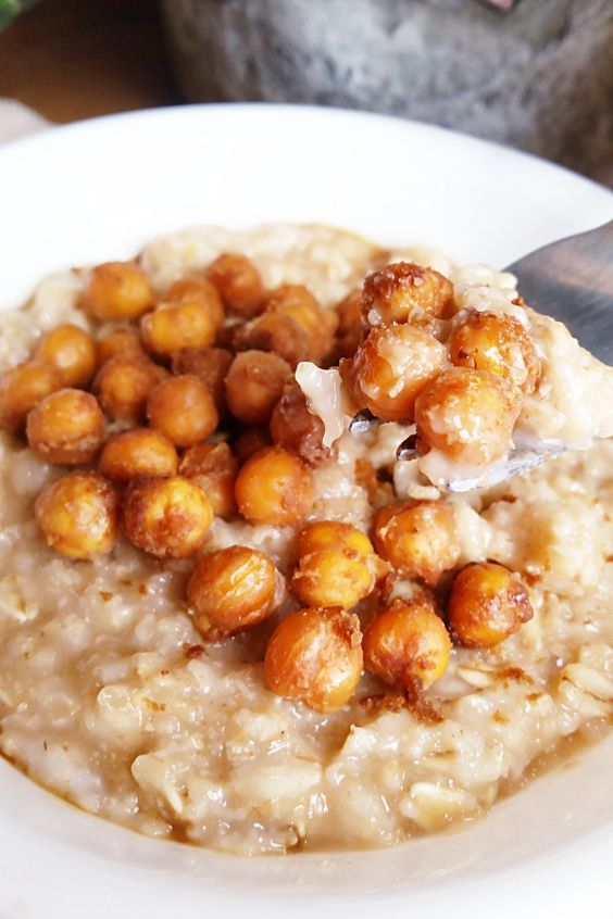 Filled with fiber and protein, this savory oatmeal topped with chickpeas roasted in peanut sauce is an easy, satisfying, and flavorful meal.