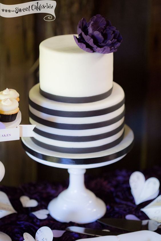 Love Notes Wedding Cake 2 tier fondant wedding cake (center of Love Notes dessert table) - with black and white fondant striped tier and a purple ruffle hand made sugar peony.