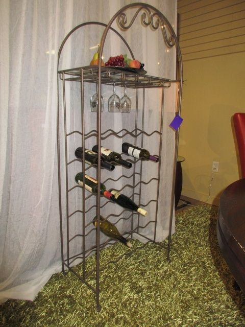 """Metal wine rack in a bronze finish. Great amount of storage for a wine rack this size! This piece can hold up to 36 bottles. There is one shelf at the top. Measures 25""""wide x 15""""deep x 60""""high. Arrived: Friday September 9th, 2016"""