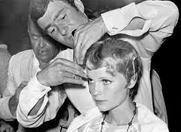 """In a boxing ring set up on the set of Polanski's Film """"Rosemary's Baby,"""" Vidal Sassoon cuts Mia Farrow's famed tresses while photojournalists go crazy."""