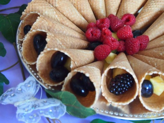 Flower Fairy Birthday Feast | CatchMyParty.com: The fruits in cones treats