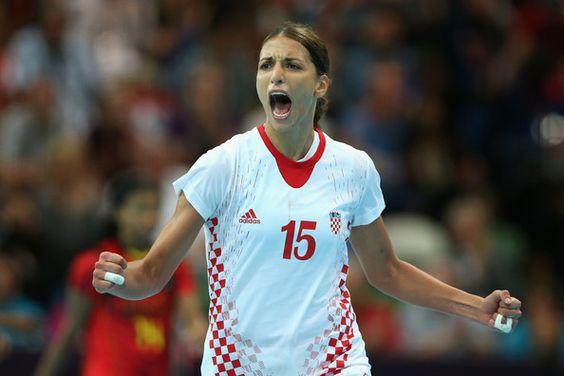 Andrea Penezic celebrates scoring for the Croatian handball team against Angola at the 2012 London Olympics