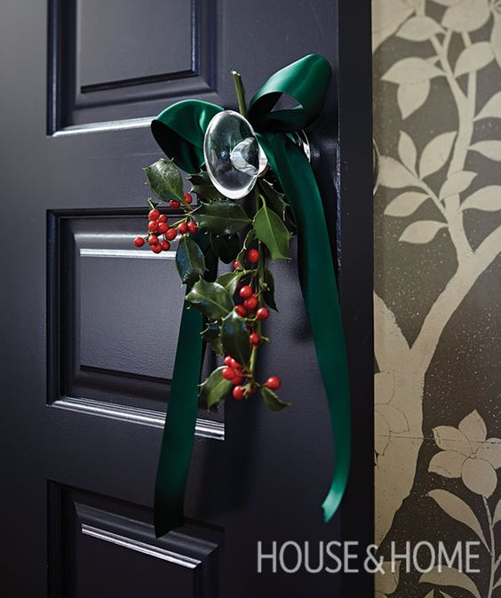 Tie a holly sprig to a doorknob with a wide satin bow to dress up a door. | Photographer: Angus Fergusson | Designer: Betty Theodoropoulos